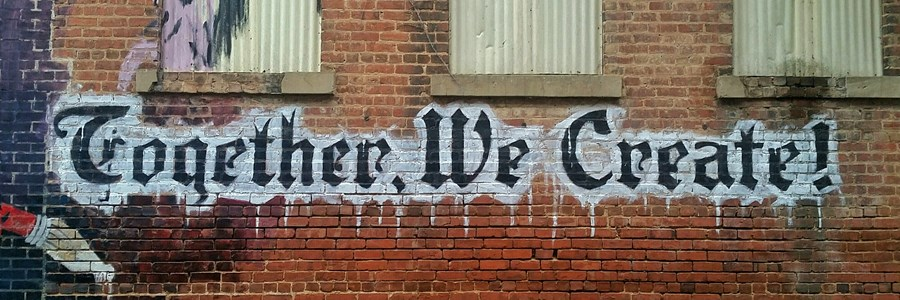 "Graffiti stating, ""Together We Create"""